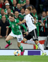 Press Eye - Belfast -  Northern Ireland - 09th September 2019 - Photo by William Cherry/Presseye . Northern Ireland\'s Gavin Whyte with Germany\'s Joshua Kimmich during Monday nights European Championship Qualifier at the National Stadium at Windsor Park, Belfast.  Photo by William Cherry/Presseye