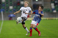 Press Eye - Belfast -  Northern Ireland - 10th July 2019 - Photo by William Cherry/Presseye/Inpho. Linfield\'s Jordan Stewart with Rosenborg\'s Birger Meling during Wednesday nights Champions League, Qualifying First Round, 1st Leg game at the National Stadium at Windsor Park, Belfast.