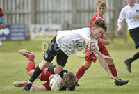 26th  July 2018. SuperCupNI 2018 Minor  section semi final between Greenisland and Portadown at Seahaven Portstewart.. Greenisland\'s Jaydyn Withers in action with Portadowns Ronan Burns.  Mandatory Credit: Stephen Hamilton /Presseye