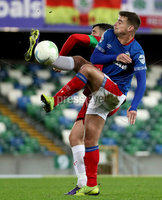 Press Eye - Belfast, Northern Ireland - 29th October 2019 - Photo by William Cherry/Presseye. Linfield\'s Matthew Clarke with Cliftonville\'s Joe Gormley during Tuesday nights BetMcLean League Cup game at Windsor Park, Belfast.     Photo by William Cherry/Presseye
