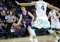 Press Eye - Belfast -  Northern Ireland - 01st December 2017 - Photo by William Cherry/Presseye. Manhattan College\'s Matt Maloney with Holy Cross\'s Clayton Le Sann during Friday afternoons Basketball Hall of Fame Belfast Classic game at the SSE Arena, Belfast.