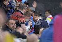Press Eye - Belfast - Northern Ireland -14th July. Photo by Stephen Hamilton  / Press Eye.. Champions league qualifying match first leg between Linfield and Celtic at Windsor park in Belfast.. Linfields chairman Roy McGivern speaks to fan s after bottles were thrown onto the pitch.
