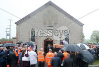 Press Eye - Belfast - Northern Ireland - 11th July 2018. Funeral for road racer William Dunlop at Garryduff Presbyterian Church outside Ballymoney in Co. Antrim.  The 32-year-old was killed while participating in the practise session of the Skerries 100 in Co. Dublin lat Saturday.  William\'s father Robert was also buried from Garryduff Presbyterian Church when he died at the North West 200 road race in 2008.. William Dunlop\'s family carry his coffin from the church after the funeral service. . Picture by Jonathan Porter/PressEye