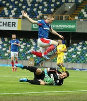 UEFA Europa League- Qualifying Third Round-2nd Leg, Windsor Park, Belfast  12/8/2019. Linfield FC vs FK FK Sutjeska. Linfield\'s  Shayne Lavery and  FK Sutjeska goalkeeper Vlado Giljen.. Mandatory Credit  INPHO/Brian Little