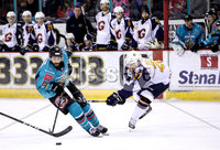 Press Eye - Belfast, Northern Ireland - 29th February 2020 - Photo by William Cherry/Presseye. Belfast Giants\' Elgin Pearce with Guildford Flames\' Ian Watters during Saturday nights Elite Ice Hockey League game at the SSE Arena, Belfast.    Photo by William Cherry/Presseye