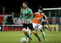 BetMcLean League Cup Round 3, The Oval, Belfast 10/10/2017. Glentoran vs Carrick Rangers. Glentoran\'s Curtis Allen with Carrick Rangers\' Mark Edgar. Mandatory Credit ©INPHO/Matt Mackey