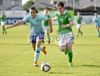 Press Eye - Belfast - Northern Ireland - 8th June. World Cup qualifier - Northern Ireland  v Netherlands at Shamrock Park Portadown.. Northern Irelands Kirsty McGuiness in action with Netherlands Renate Jansen. Mandatory Credit: Presseye/Stephen Hamilton