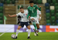 Press Eye-Belfast-Northern Ireland -12th November 2020. National Football Stadium at Windsor Park, Belfast. . 12/11/2020. Northern Ireland Jamal Lewis and Slovakia  Albert Rusnak  during Thursday  night\'s UEFA Euro 2020  Play-off Final  at the National Football Stadium at Windsor Park,Belfast.. Mandatory Credit PressEye