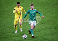 Press Eye - Belfast, Northern Ireland - 18th November 2020 - Photo by William Cherry/Presseye. Northern Ireland\'s Ethan Galbraith with Romania\'s Cristian Ganea during Wednesday nights UEFA Nations League game at the National Football Stadium at Windsor Park, Belfast. Photo by William Cherry/Presseye