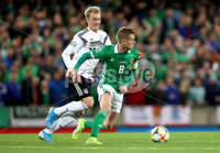 Press Eye - Belfast -  Northern Ireland - 09th September 2019 - Photo by William Cherry/Presseye . Northern Ireland\'s Steven Davis  with Germany\'s Julian Brandt during Monday nights European Championship Qualifier at the National Stadium at Windsor Park, Belfast.  Photo by William Cherry/Presseye