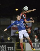 12th September 2017 . Danske Bank Irish premier league match between Crusaders and Linfield at Seaview.. Crusaders Sean Ward  in action with Linfields Aaron Burns.  Photo by Stephen Hamilton /Inpho