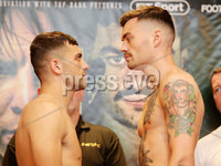 Press Eye - Belfast - Northern Ireland - 29th June 2018. Weigh in at the Europa Hotel in Belfast ahead of Michael Conlan\'s homecoming fight against Brazilian Adeilson Dos Santos at the SSE Arena on Saturday night. . Left to right.  Jack Catterall and Tyrone McKenna go head-to-head after the weigh in. . Picture by Jonathan Porter/PressEye