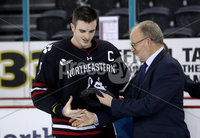 Press Eye - Belfast, Northern Ireland - 30th November 2019 - Photo by William Cherry/Presseye. Eric Porter, Chairman Odyssey Trust, presents Northeastern Huskies\' Ryan Shea with the man of the game award after Saturday evenings Friendship Four Championship game against Colgate Raiders at the SSE Arena, Belfast.      Photo by William Cherry/Presseye