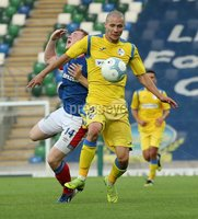 UEFA Europa League- Qualifying Third Round-2nd Leg, Windsor Park, Belfast  12/8/2019. Linfield FC vs FK FK Sutjeska. FK Sutjeska Aleksandar Sofranac second yellow card challenge on Linfield\'s Shayne Lavery  .. Mandatory Credit  INPHO/Brian Little