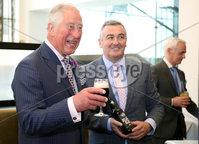 22 May 2019, Mandatory Credit Press Eye/Darren Kidd.  The Prince of Wales and Duchess of Cornwall during their visit to The Grand Central Hotel Belfast on the second day of their visit to Northern Ireland. . The Prince of Wales samples Belfast Black with Bernard Sloan of Whitewater Brewery