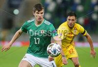 Press Eye - Belfast - Northern Ireland - 12th November 2020. UEFA Nations League 2021 - Northern Ireland Vs Romina at The National Stadium at Windsor Park, Belfast.. Northern Irelands Paddy McNair with Rominas Camora. Picture by Jonathan Porter/PressEye