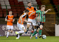 BetMcLean League Cup Round 3, The Oval, Belfast 10/10/2017. Glentoran vs Carrick Rangers. Glentoran\'s Steven Gordon with Carrick Rangers\' Ben Roy. Mandatory Credit ©INPHO/Matt Mackey