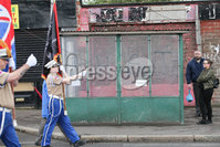 PressEye - Belfast - Northern Ireland - 17 April 2017. Pictured: Members of the Apprentice Boys of Derry Ligoniel Walker Club walk down the Crumlin Road in north Belfast past Ardoyne shops.. Picture: Philip Magowan / PressEye