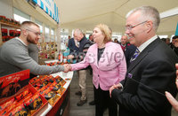 Press Eye - Belfast - Northern Ireland - 16th May 2019. Second day of the Balmoral Show, in partnership with Ulster Bank.  Pictured at Balmoral Park, outside Lisburn, are the Secretary of State for Northern Ireland Karen Bradley(centre) and Head of Ulster Bank Richard Donnan(right) who meet David Knowles(left) at his sewer potato crisps Wolf and Woodsman business stall.  Ulster Bank has provided space in its market at Balmoral Show to entrepreneurs from Ulster Bank\'s Entrepreneur Accelerator programme as well as small business customers. . Picture by Jonathan Porter/PressEye