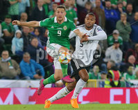 Press Eye - Belfast - Northern Ireland - 9th September 2019 . UEFA EURO Qualifier Group C at the National Stadium at Windsor Park, Belfast.  Northern Ireland Vs Germany. . Northern Ireland\'s Conor Washington with Germany\'s Jonathan Tah.  . Photo by Jonathan Porter / Press Eye.