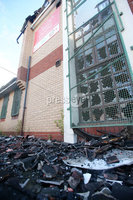 Press Eye - Belfast - Northern Ireland - 8th August 2017 . The Credit Union building in the Divis area of west Belfast which was set on fire last night following trouble across Belfast after bonfire material was moved by agencies from the Markets in south Belfast. . Photo by Jonathan Porter / Press Eye.
