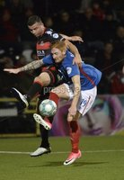 12th September 2017 . Danske Bank Irish premier league match between Crusaders and Linfield at Seaview.. Crusaders Colin Coates  in action with Linfields Louis Rooney.  Photo by Stephen Hamilton /Inpho