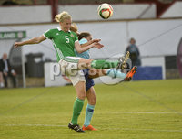 Press Eye - Belfast - Northern Ireland - 8th June. World Cup qualifier - Northern Ireland  v Netherlands at Shamrock Park Portadown.. Northern Irelands Julie Nelson  in action with Netherlands Danielle van de Donk. Mandatory Credit: Presseye/Stephen Hamilton