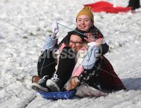 ©Lorcan Doherty February 12th 2018. . Hannah Melaugh (11) and Josephine Nelis (14) enjoying the Mid Term Break snow fall in Brooke Park.