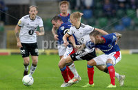 Press Eye - Belfast -  Northern Ireland - 10th July 2019 - Photo by William Cherry/Presseye/Inpho. Linfield\'s Jamie Mulgrew and Kirk Millar with Rosenborg\'s Birger Meling during Wednesday nights Champions League, Qualifying First Round, 1st Leg game at the National Stadium at Windsor Park, Belfast.