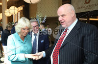 22 May 2019, Mandatory Credit Press Eye/Darren Kidd.  The Prince of Wales and Duchess of Cornwall during their visit to The Grand Central Hotel Belfast on the second day of their visit to Northern Ireland. . Duchess of Cornwall with Willie Jack, owner of Charming Quirky Pub\'s in Belfast\'s Cathedral Quarter.