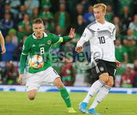 Press Eye - Belfast - Northern Ireland - 9th September 2019 . UEFA EURO Qualifier Group C at the National Stadium at Windsor Park, Belfast.  Northern Ireland Vs Germany. . Northern Ireland\'s Steven Davis with Germany\'s Julian Brandt. Photo by Jonathan Porter / Press Eye.