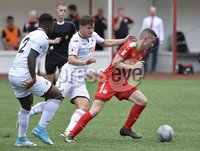 Press Eye - Belfast - Northern Ireland -15th July. Photo by Stephen Hamilton  / Press Eye.. Pre season friendly match between Cliftonville and Swansea u23 at Solitude in Belfast.. Cliftonvilles Daniel Hughes  in action with Swansea\'s Adnan Maric