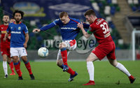 Press Eye - Belfast, Northern Ireland - 29th October 2019 - Photo by William Cherry/Presseye. Linfield\'s Shayne Lavery with Cliftonville\'s Joe Gorman during Tuesday nights BetMcLean League Cup game at Windsor Park, Belfast.     Photo by William Cherry/Presseye
