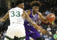 Press Eye - Belfast -  Northern Ireland - 01st December 2017 - Photo by William Cherry/Presseye. Manhattan College\'s Pauly Paulicap with Holy Cross\'s Jehyve Floyd  during Friday afternoons Basketball Hall of Fame Belfast Classic game at the SSE Arena, Belfast.