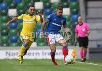 UEFA Europa League- Qualifying Third Round-2nd Leg, Windsor Park, Belfast  12/8/2019. Linfield FC vs FK FK Sutjeska. Linfield\'s  Matthew Clarke         and  Damir Kojasevic     of FK Sutjeska.. Mandatory Credit  INPHO/Brian Little