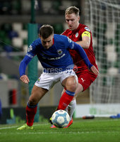 Press Eye - Belfast, Northern Ireland - 29th October 2019 - Photo by William Cherry/Presseye. Linfield\'s Matthew Clarke with Cliftonville\'s Christopher Curran during Tuesday nights BetMcLean League Cup game at Windsor Park, Belfast.     Photo by William Cherry/Presseye