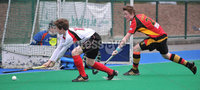 Mandatory Credit: Rowland White/Presseye. Hockey: Super 9\'s Finals. Teams: Banbridge Bears (red) v Dale Dragons (white). Venue: Banbridge. Date: 25th April 2012. Caption: Michael Robson, Dale and Ben Cosgrove, Bears
