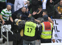 Press Eye - Belfast - Northern Ireland -14th July. Photo by Stephen Hamilton  / Press Eye.. Champions league qualifying match first leg between Linfield and Celtic at Windsor park in Belfast..  Celtics Mikael Lustig gives a young fan his shirt after tonights game.