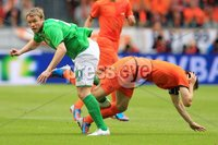 ©Press Eye Ltd Northern Ireland - 1st June 2012. Mandatory Credit - Picture by Darren Kidd/Presseye.com .  . Netherlands v Northern Ireland at the Amsterdam Arena.. Northern Ireland\'s Grant McCann with Holland\'s Mark van Bommel