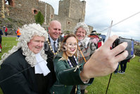 Press Eye - Belfast - Northern Ireland  - 13th July 2017 - . Paul Reid, Mayor of Mid and East Antrim. Deputy Mayor Cheryl Johnston, David Hilditch MLA and Terry Clements take part in the re-enactment of the Siege of Carrickfergus Castle and the landing of King William at Castle Green, Carrickfergus. The event included re-enactment groups from across the Northern Oteland, all dressed in period costume followed by a Pageantry parade to meet King William upon his landing at Carrick Harbour. . Photo by Kelvin Boyes / Press Eye..