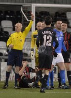 Press Eye - Northern Ireland -12th February 2016. Photograph:Presseye /Stephen Hamilton. Danske Bank Irish premier league match betweeen Crusaders and Glenavon at Seaview Belfast.. Glenavons Eoin Bradley floors Crusaders Colin Coates and sees a red card by referee Raymond Heatherington