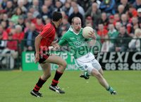 Presseye Northern Ireland - 03rd June 2012 Mandatory Credit - Photo-William Cherry/Presseye. Fermanagh\'s Conor Quigley with Down\'s Aiden Branagan during Sundays Ulster Senior  Championship Quarter Final at Brewster Park, Enniskillen.