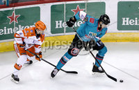 Press Eye - Belfast, Northern Ireland - 06th December 2019 - Photo by William Cherry/Presseye. Belfast Giants\' Paul Swindlehurst with Sheffield Steelers\' Lucas Sandstrom during Friday nights Elite Ice Hockey League game at the SSE Arena, Belfast.       Photo by William Cherry/Presseye