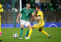Press Eye - Belfast, Northern Ireland - 18th November 2020 - Photo by William Cherry/Presseye. Northern Ireland\'s Jonny Evans with Romania\'s Florin Tanase during Wednesday nights UEFA Nations League game at the National Football Stadium at Windsor Park, Belfast. Photo by William Cherry/Presseye
