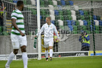 Press Eye - Belfast - Northern Ireland -14th July. Photo by Stephen Hamilton  / Press Eye.. Champions league qualifying match first leg between Linfield and Celtic at Windsor park in Belfast.. Celtics Leigh Griffiths ties a Celtic scarf onto the post which infuriates Linfield supporters .