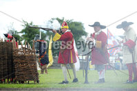 Press Eye - Belfast - Northern Ireland  - 13th July 2017 - . General views of the re-enactment of the Siege of Carrickfergus Castle and the landing of King William at Castle Green, Carrickfergus. The event included re-enactment groups from across the Northern Oteland, all dressed in period costume followed by a Pageantry parade to meet King William upon his landing at Carrick Harbour. . Photo by Kelvin Boyes / Press Eye..