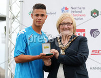 Press Eye - Belfast - Northern Ireland - 27th July 2018. SuperCupNI Cup International Youth Football Tournament at Ballymena\'s Showgrounds.  Supercut Final.  B Italia Vs Co. Down.. Cllr Brenda Chivers presents B Italia\'s Bingo Marco with man of the match. . .. Picture by Jonathan Porter/PressEye