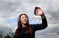 Press Eye - Belfast -  Northern Ireland - 18th May 2018 - Photo by William Cherry/Presseye. Charlotte Caldwell with the her 12 year old son Billy\'s legally-prescribed cannabis oil on the NHS for his severe epilepsy.