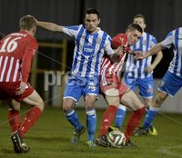 Presseye.com 20th  December  2014. Danske Bank Irish premier league match between Coleraine and Warrenpoint town at Ballycastle road Coleraiane.. Colleraines  Conor McCaffertyy  in action with Warrenpoints Daniel Hughes. Photograph:Stephen Hamilton