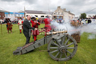 Press Eye - Belfast - Northern Ireland  - 13th July 2017 - . Paul Reid, Mayor of Mid and East Antrim lights a cannon as part of  the re-enactment of the Siege of Carrickfergus Castle and the landing of King William at Castle Green, Carrickfergus. The event included re-enactment groups from across the Northern Oteland, all dressed in period costume followed by a Pageantry parade to meet King William upon his landing at Carrick Harbour. . Photo by Kelvin Boyes / Press Eye..